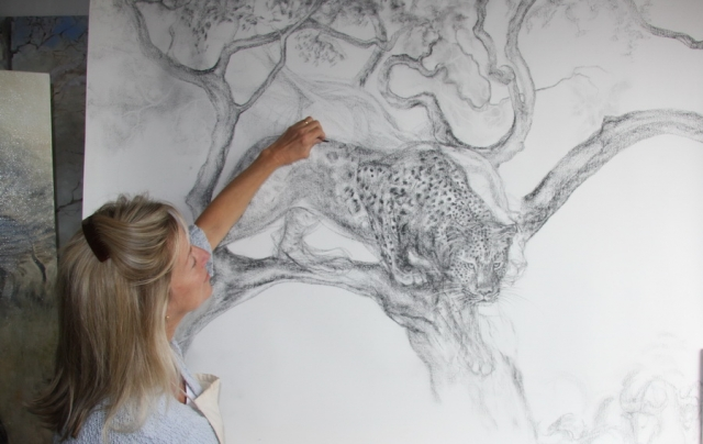 Charcoal Drawing of a Leopard with Artist